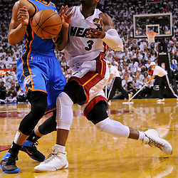 Jun 17, 2012; Miam, FL, USA; Miami Heat shooting guard Dwyane Wade (3) draws a foul from Oklahoma City Thunder point guard Russell Westbrook (0)during the fourth quarter in game three in the 2012 NBA Finals at the American Airlines Arena. Mandatory Credit: Derick E. Hingle-US PRESSWIRE