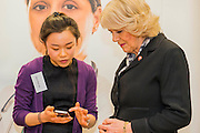 Her Royal Highness meets the team developing a website (www.centre-adolsecent-rheumatology.org) and phone app (being shown to her by Alice Ran Cai).The Duchess of Cornwall, Patron, Arthritis Research UK, visits and meets patients of the Adolescent Inpatient Unit at University College London Hospitals.  •	Her Royal Highness then tours a laboratory at the Arthritis Research UK Centre for Adolescent Rheumatology and meeting researchers and supporters. London 12 Feb 2015.