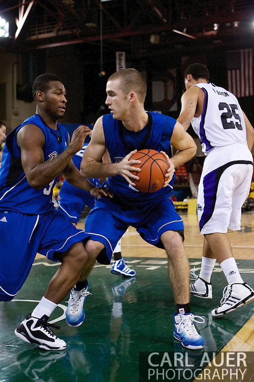 November 27th, 2010:  Anchorage, Alaska - Drake Bulldog forward Aaron Hawley (2) grabs a rebound in the Bulldog's 81-82 loss to Weber State in the third place game of the Great Alaska Shootout.