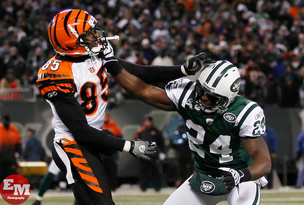 Jan 3, 2010; East Rutherford, NJ, USA; Cincinnati Bengals wide receiver Chad Ochocinco (85) and New York Jets cornerback Darrelle Revis (24) battle for position during the first half at Giants Stadium.