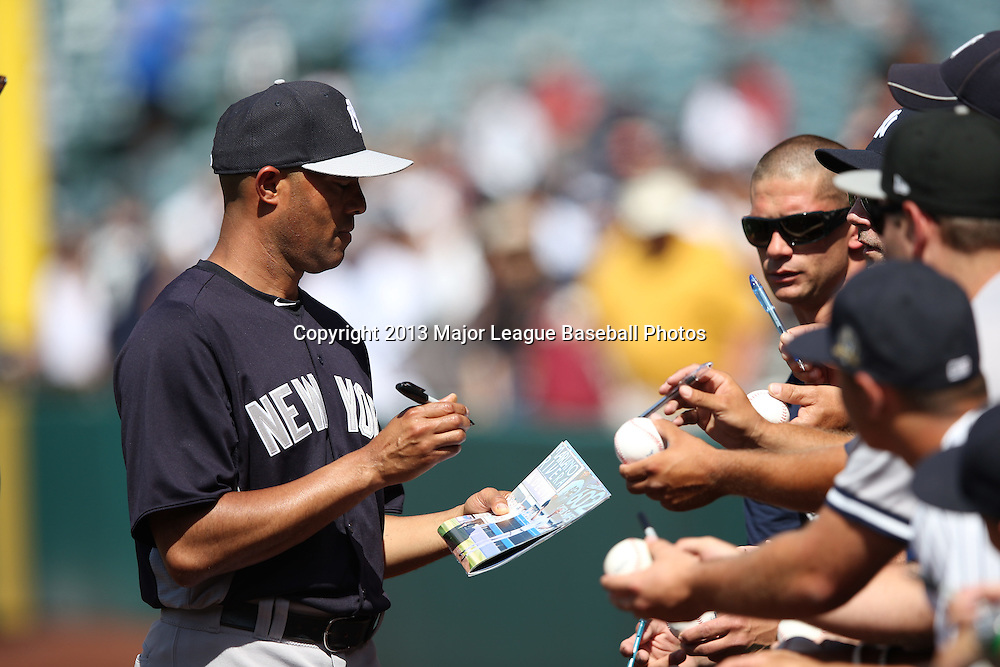 ANAHEIM, CA - JUNE 15:  Mariano Rivera #42 of the New York Yankees signs fan autographs before the game against the Los Angeles Angels of Anaheim on Saturday, June 15, 2013 at Angel Stadium in Anaheim, California. The Angels won the game 6-2. (Photo by Paul Spinelli/MLB Photos via Getty Images) *** Local Caption *** Mariano Rivera