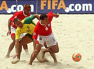Football - FIFA Beach Soccer World Cup 2006 - Final - BRA X URU - Rio de Janeiro - Brazil 12/11/2006<br />Buru (BRA) fights for the ball with Damian (6) and Coco during the match Event Title Board Mandatory Credit: FIFA / Ricardo Moraes