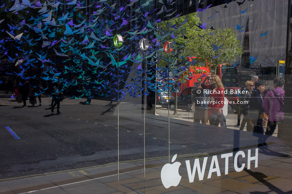 Apple Watches displayed in a corner window of department store, Selfridges in Oxford Street central London.