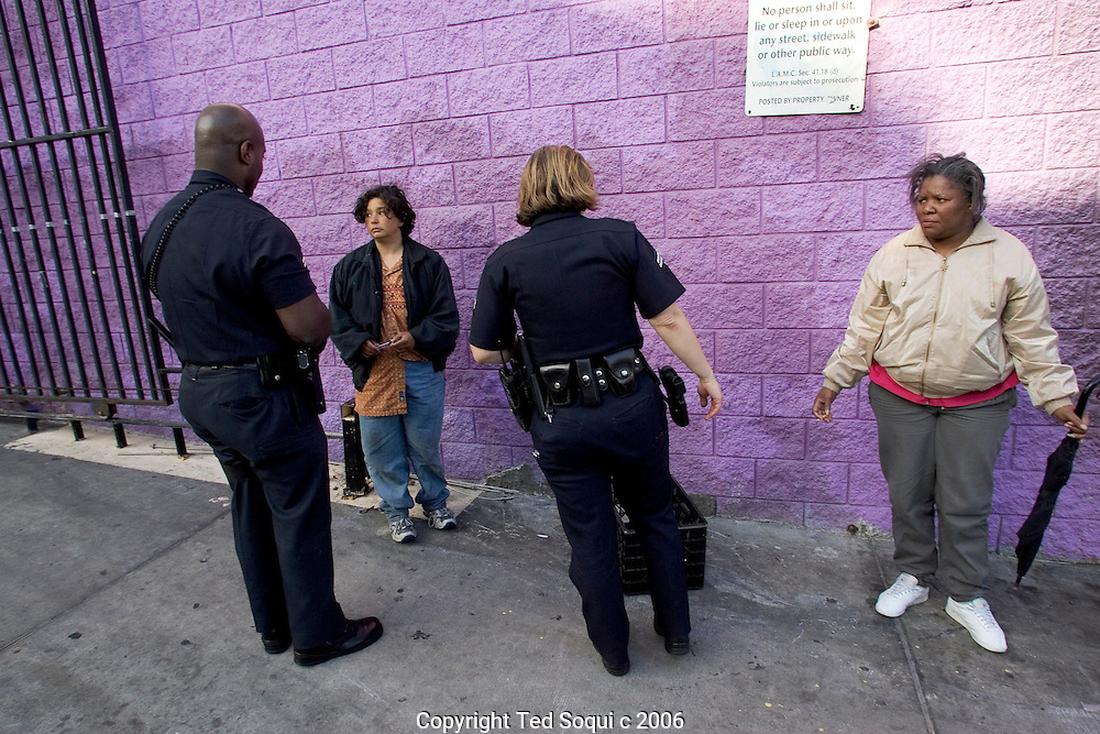 LAPD Senior Lead Officers Deon Joseph and Kathy McAnany check out some homeless women  in Down LA's skid row.