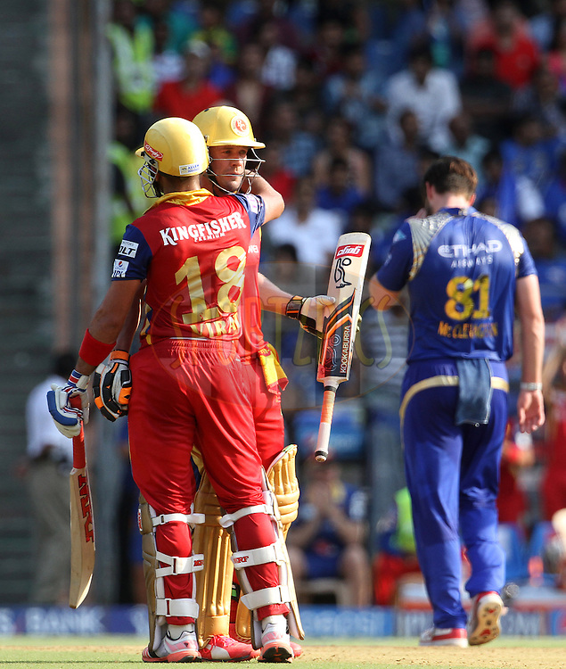 Royal Challengers Bangalore captain Virat Kohli congratulates Royal Challengers Bangalore player AB De Villiers after he scores a fifty during match 46 of the Pepsi IPL 2015 (Indian Premier League) between The Mumbai Indians and The Royal Challengers Bangalore held at the Wankhede Stadium in Mumbai, India on the 10th May 2015.<br /> <br /> Photo by:  Vipin Pawar / SPORTZPICS / IPL