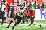 Tampa Bay Buccaneers Defensive Back Vernon Hargreaves (28)  tackles Carolina Panthers Wide Receiver D. J. Moore (12) during the International Series match between Tampa Bay Buccaneers and Carolina Panthers at Tottenham Hotspur Stadium, London, United Kingdom on 13 October 2019.