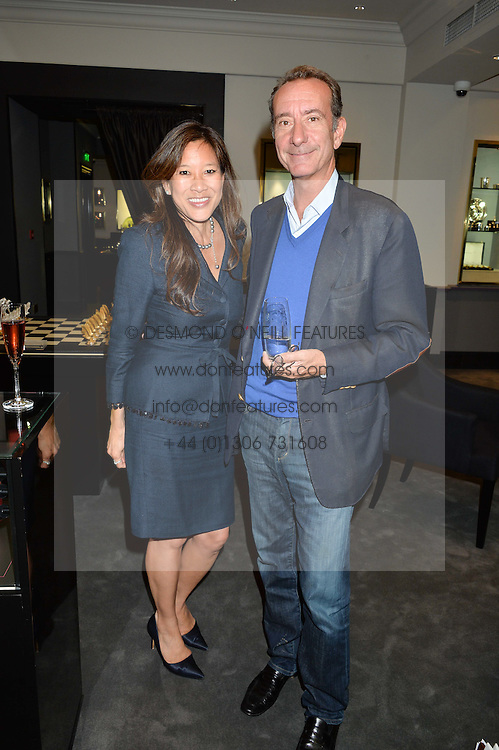 LISA TSENG and the HON.ROBERT HANSON at a party to celebrate the publication of the Summer edition og the Fitzdares Times held at Theo Fennell, 169 Fulham Road, London on 13th June 2016.