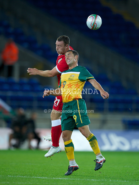 CARDIFF, WALES - Wednesday, August 10, 2011: Wales' Darcy Blake in action against Australia's Scott McDonald during an International Friendly match at the Cardiff City Stadium. (Photo by David Rawcliffe/Propaganda)