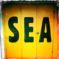 SEA writing on a door