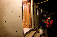 A girl stands outside looking into her rented apartment house after someone riddled the house with bullets on Friday, March 6, 2009.  Drug cartel members were trying to send a message to the owner of the house.