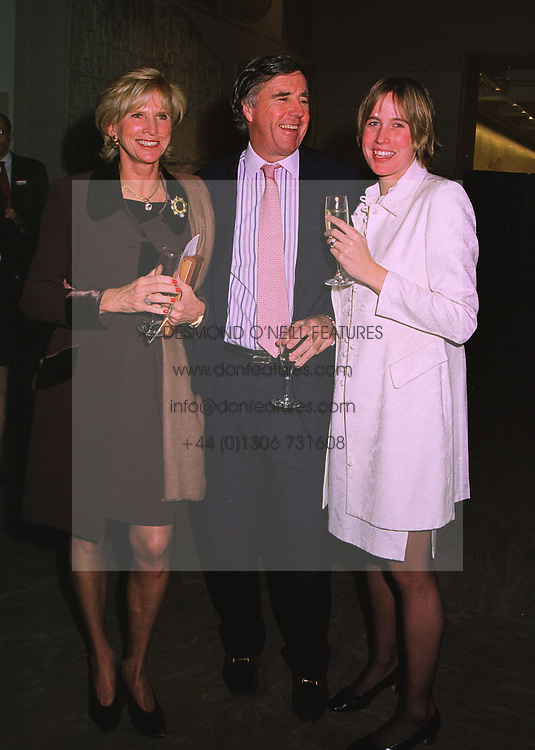 Left to right, MR & MRS HARRY FITZGIBBONS and their daughter MRS PATRICK MILES, at an exhibition in London on 13th November 1997.MDH 47