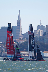 Oracle Team USA skippered by James Spithill and Emirates Team New Zealand skippered by Dean Barker sails in the San Francisco Bay during the 2013 America's Cup Finals San Francisco, California.