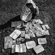 A woman dries her identity papers after crossing the Nap River by night near Sha Pohrir DwipSince the end of august 2017, the beginning of the crisis, more than 600,000 Rohingyas have fled Myanmar to seek refuge in Bangladesh. Cox's Bazar - november 5th 2017.<br /> Une femme fait s&eacute;cher ses papiers d'identit&eacute; apr&egrave;s avoir travers&eacute; la rivi&egrave;re Nap de nuit &agrave; proximit&eacute; de Sha Pohrir Dwip. Depuis le d&eacute;but de la crise, fin ao&ucirc;t 2017, plus de 600000 Rohingyas ont fuit la Birmanie pour trouver refuge au Bangladesh. Cox's Bazar le 05 novembre 2017.