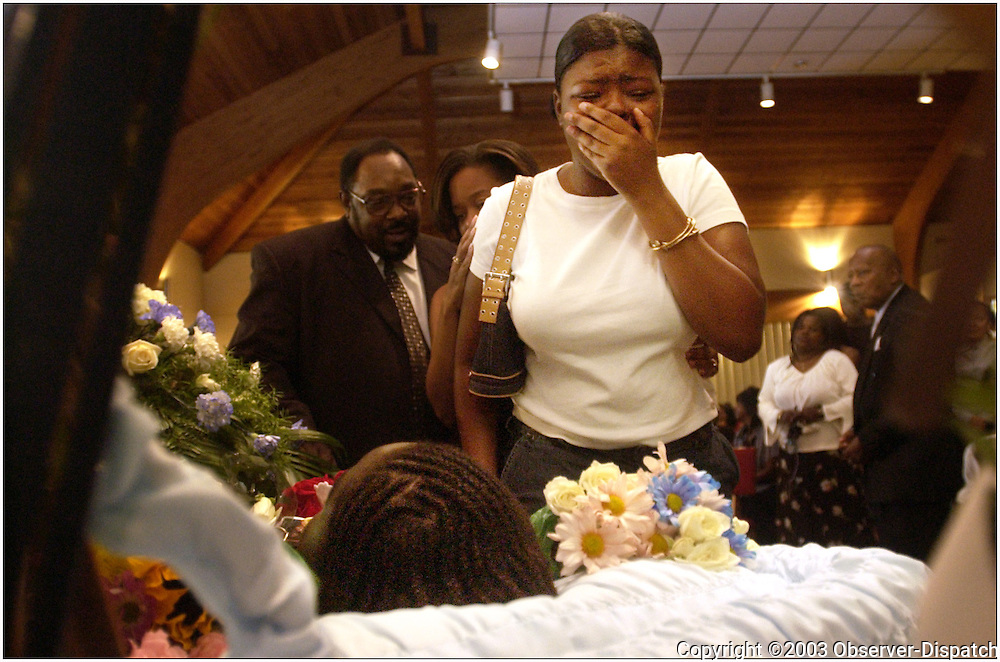 Jaleesa Garrett of Buffalo, cousin of slain 17-year-old Utican Tordell Garrett, attempts to constrain her outpouring of grief as she views Tordell for the last time before he is laid to rest at his funeral services Saturday afternoon at St. Paul's Baptist Church on Leah Street in Utica.