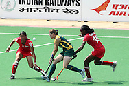 Kathleen Taylor tries to break through during the women's hockey match of the The Commonwealth Games between South Africa and Trinidad and Tobago held at the Stadium in New Delhi, India on the  October 2010..Photo by:  Ron Gaunt/SPORTZPICS/PHOTOSPORT