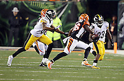 Pittsburgh Steelers running back Fitzgerald Toussaint (33) runs the ball while Pittsburgh Steelers wide receiver Darrius Heyward-Bey (88) tries to block Cincinnati Bengals strong safety Shawn Williams (36) during the NFL AFC Wild Card playoff football game against the Cincinnati Bengals on Saturday, Jan. 9, 2016 in Cincinnati. The Steelers won the game 18-16. (©Paul Anthony Spinelli)