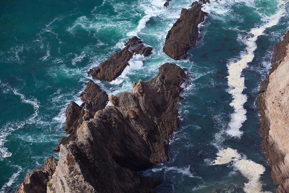 Waves collide upon rocks along Route 1 in Central California.