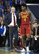 Feb 28, 2019; Los Angeles, CA, USA; Southern California Trojans head coach Andy Enfield (left) talks with guard Kevin Porter Jr. (4)  in the first half against the UCLA Bruins at Pauley Pavilion. UCLA defeated USC 93-88 in overtime.