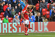 Nottingham Forest forward Britt Assombalonga (9)  and Nottingham Forest midfielder Hildeberto Pereira (17) celebrate the goal 1-0 during the EFL Sky Bet Championship match between Nottingham Forest and Queens Park Rangers at the City Ground, Nottingham, England on 5 November 2016. Photo by Simon Trafford.
