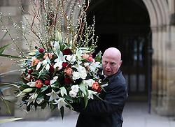© Licensed to London News Pictures . 18/03/2016 . Manchester , UK. Flowers being carried out of the church after the service.. Television stars and members of the public attend the funeral of Coronation Street creator Tony Warren at Manchester Cathedral . Photo credit : Joel Goodman/LNP