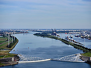 Nederland, Zuid-Holland, Hoek van Holland, 14-09-2019; Nieuwe Waterweg, Haven van Rotterdam. Functioneringssluiting Maeslantkering. De waterkering in de Nieuwe Waterweg wordt een maal per jaar, voordat het stormseizoen begint, getest. Tijdens het sluiten van de kering ligt alle scheepvaartverkeer naar de Rotterdamse haven stil. Aan de horizon Rotterdam, rechts Callandkanaal en de havens van Europoort. De Maeslantkering sluit normaal gesproken alleen bij dreigende stromvloed en bij een waterstand van 3 meter of meer boven NAP. De kering, onderdeel van de Deltawerken, vormt samen met de Hartelkering de Europoortkering en beschermt Rotterdam en achterland bij extreme waterstanden.<br /> Hook of Holland - Port of Rotterdam. Aerial view of the new storm surge barrier (Maeslantkering) in the Nieuwe Waterweg during the so-called functioning closure, taking place one a year before the storm season begins. The waterway, leading to the Port of Rotterdam (at the horizon), is closed during the test. <br /> luchtfoto (toeslag op standard tarieven);<br /> aerial photo (additional fee required);<br /> copyright foto/photo Siebe Swart