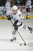 KELOWNA, CANADA, NOVEMBER 9: Tyson Ness #22 of the Red Deer Rebels takes a shot during warm up  as the Red Deer Rebels visit the Kelowna Rockets  on November 9, 2011 at Prospera Place in Kelowna, British Columbia, Canada (Photo by Marissa Baecker/Shoot the Breeze) *** Local Caption ***