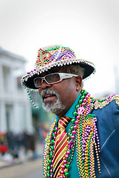 04 March 2014. New Orleans, Louisiana.<br /> Snappy dresser. A face in the crowd awaiting early morning Krewe of Zulu parade.<br /> Photo; Charlie Varley/varleypix.com
