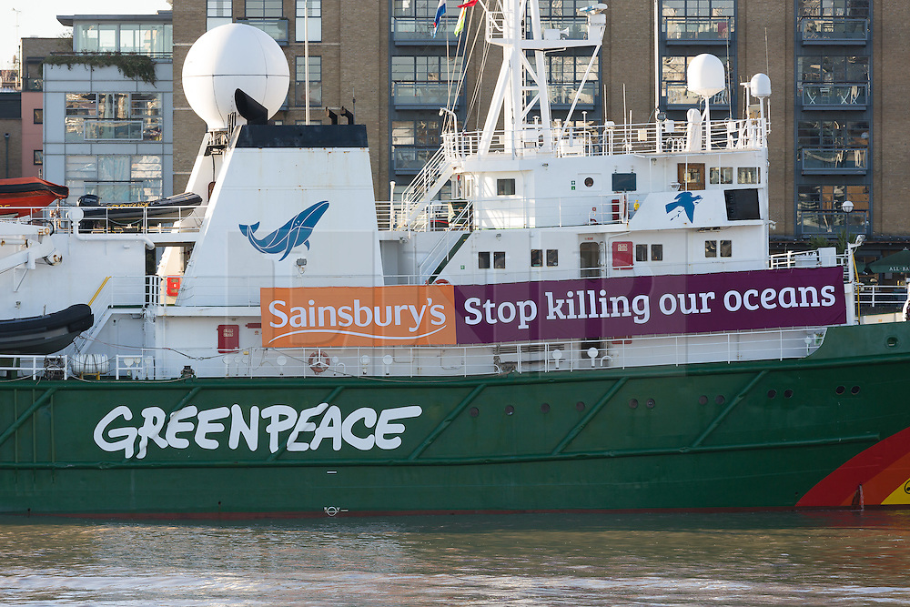 """© Licensed to London News Pictures. 19/11/2016. LONDON, UK.  The Greenpeace ship, MY Esperanza arrives and moors at Butlers Wharf, near Tower Bridge in central London with a banner calling on the supermarket Sainsbury's to """"stop killing our oceans"""".   The Esperanza has recently returned from the Indian Ocean where Greenpeace worked to expose destructive fishing practices of John West and its owner Thai Union, which claim to show harm to all kinds of marine life including sharks and turtles in the pursuit of the tuna fish, which is sold by Sainsbury's supermarket. Tesco and Waitrose supermarkets have already committed to remove John West's tuna from their shelves, but Sainsbury's currently still sells and profit from John West tuna. Photo credit: Vickie Flores/LNP"""