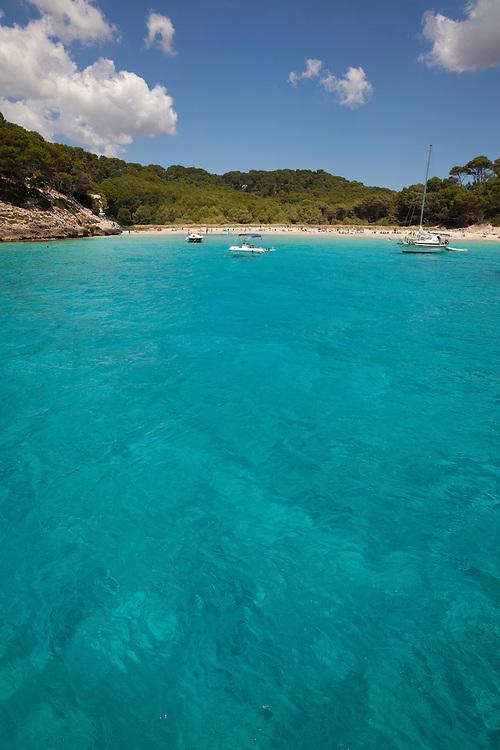 Turquese waters, at Trebaluger beach in Menorca, Spain.