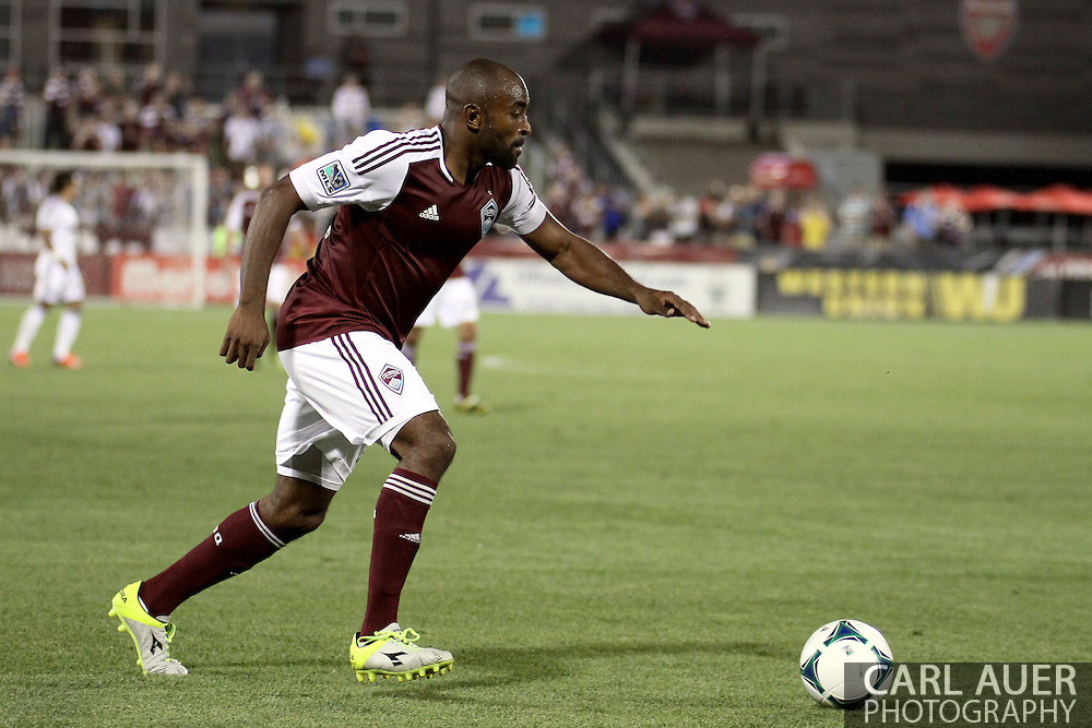 August 17th, 2013 - Colorado Rapids defender Marvell Wynne (22) sets to cross a pass in the second half of action in the Major League Soccer match between the Vancouver Whitecaps FC and the Colorado Rapids at Dick's Sporting Goods Park in Commerce City, CO