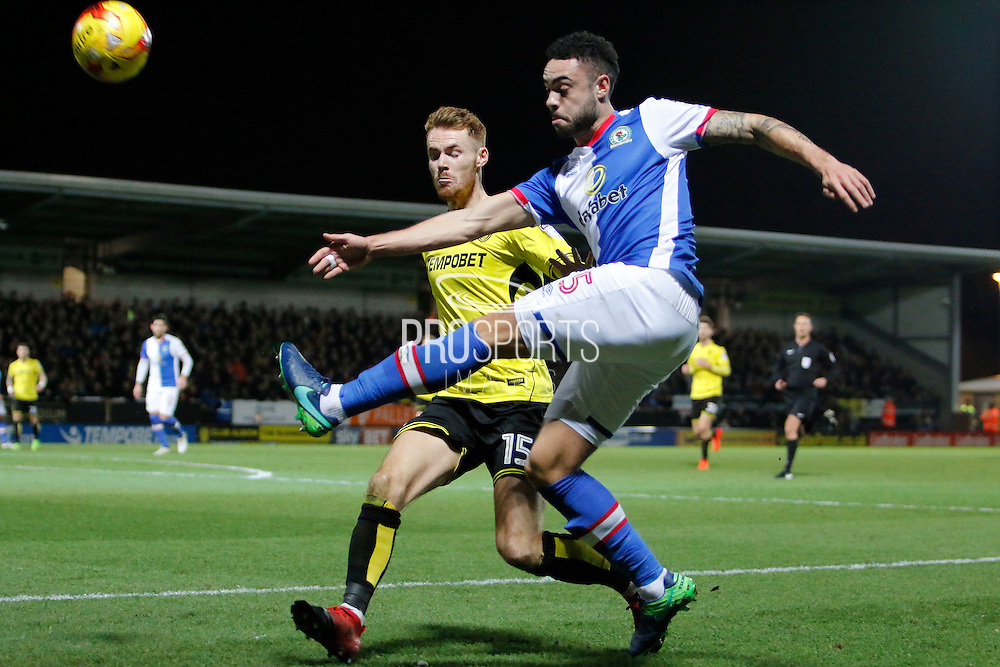 Burton Albion midfielder Tom Naylor (15) and Blackburn Rovers defender Derrick Williams (5) during the EFL Sky Bet Championship match between Burton Albion and Blackburn Rovers at the Pirelli Stadium, Burton upon Trent, England on 24 February 2017. Photo by Richard Holmes.