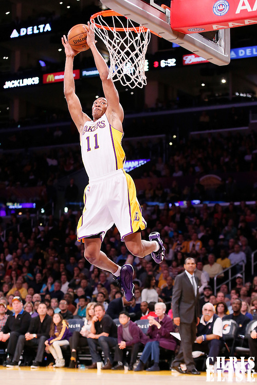 17 November 2013: Los Angeles Lakers shooting guard Wesley Johnson (11) dunks on an alley-oop during the Los Angeles Lakers 114-99 victory over the Detroit Pistons at the Staples Center, Los Angeles, California, USA.