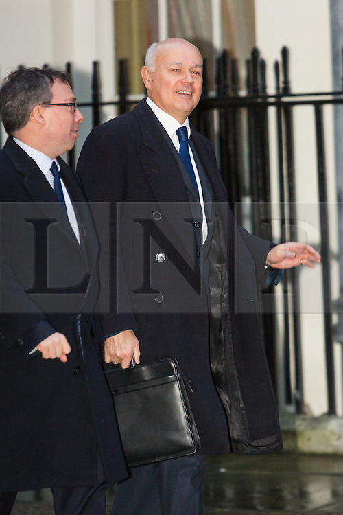 © Licensed to London News Pictures. 15/12/2015. London, UK. IAIN DUNCAN SMITH arrives for a cabinet meeting in Downing Street. Photo credit : Vickie Flores/LNP