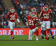 Kansas City Chiefs Sean Smith celebrating tackling the quaterback during the Kansas City Chiefs v Detroit Lions  NFL International Series match at Wembley Stadium, London, England on 1 November 2015. Photo by Matthew Redman.