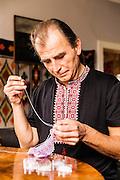 Krywulki - traditional hand made jewellery of carpathian highlanders called Boyko photography by Piotr Gesicki