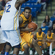 02/01/12 Newark DE: George Mason Sophomore Guard Sherrod Wright #10 battles Delaware Junior Forward #32 Josh Brinkley under the basket during a Colonial Athletic Association conference Basketball Game against Delaware Wed, Feb. 1, 2012 at the Bob Carpenter Center in Newark Delaware.