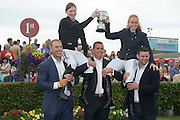 28/07/2014 Stephan Ferris, Alan Quinlan and Fergus McFadden hold Nenagh Carberry and Jane Mannion aloft as they both rode the most winners last year . The Galway Summer Racing Festival at Ballybrit in Galway City continues till Sunday. Photo:Andrew Downes
