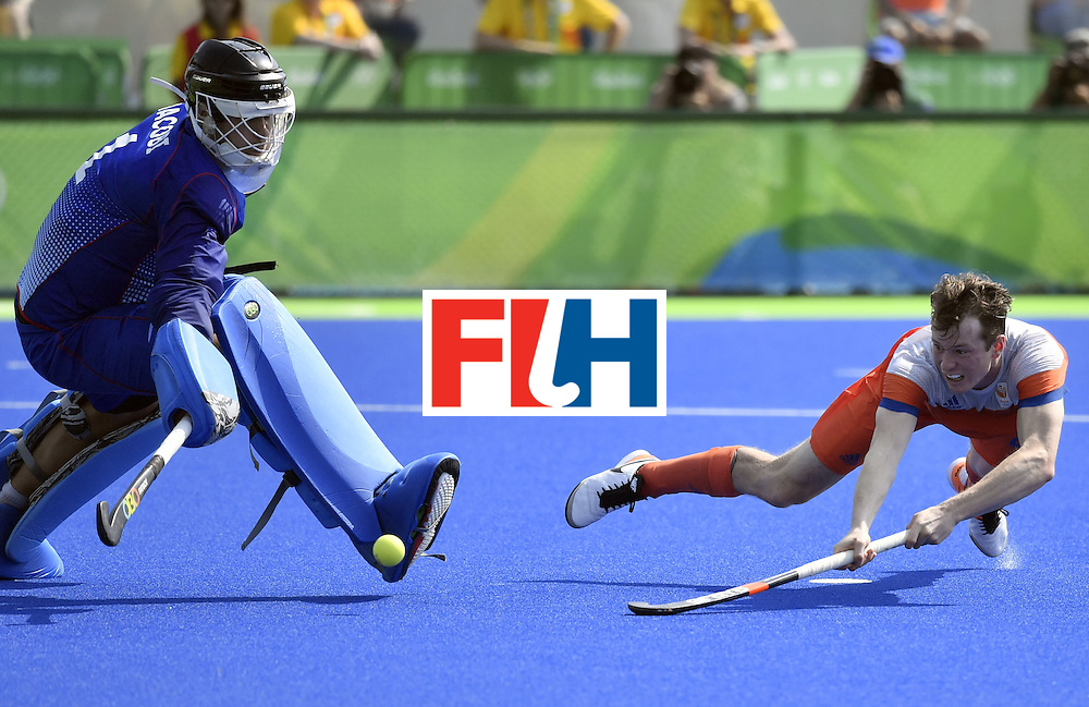 Netherlands' Seve van Ass (R) scores a goal during the penalty shoot-out of the men's Bronze medal field hockey Netherlands vs Germany match of the Rio 2016 Olympics Games at the Olympic Hockey Centre in Rio de Janeiro on August 18, 2016. / AFP / PHILIPPE LOPEZ        (Photo credit should read PHILIPPE LOPEZ/AFP/Getty Images)