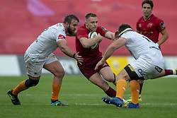 September 1, 2018 - Limerick, Ireland - Rory Scannell of Munster tackled by Jacques du Toit and Charles Marais of Cheetahs during the Guinness PRO14 rugby match between Munster Rugby and Toyota Cheetahs at Thomond Park Stadium in Limerick, Ireland on September 1, 2018  (Credit Image: © Andrew Surma/NurPhoto/ZUMA Press)