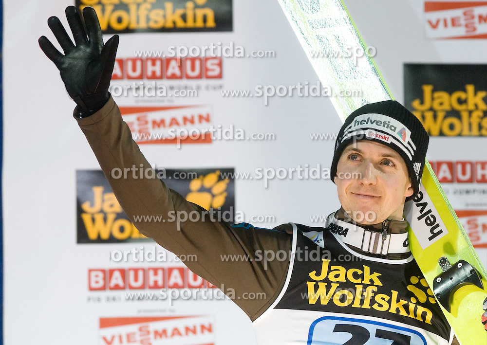 Third placed Simon Ammann of Switzerland celebrates at the medal ceremony at the last of the FIS Ski Jumping World Cup event of the 58th Four Hills ski jumping tournament, on January 6, 2010 in Bischofshofen, Austria. (Photo by Vid Ponikvar / Sportida)