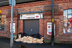 © Licensed to London News Pictures. 26/02/2020. Ironbridge, UK. Sandbags at a business entrance in Ironbridge as flood defences were breached on part of the River Severn as levels continued to rise police evacuated part of the town. Photo credit: Peter Manning/LNP