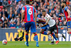 Marcus Rashford of Manchester United goes down awkwardly and injures himself as he competes with Wilfried Zaha of Crystal Palace - Mandatory byline: Rogan Thomson/JMP - 21/05/2016 - FOOTBALL - Wembley Stadium - London, England - Crystal Palace v Manchester United - FA Cup Final.