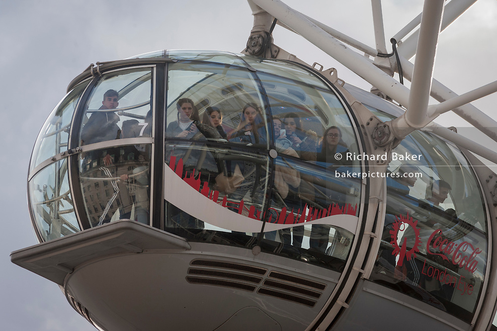 Tourists (potential witnesses) allowed by police to leave the London Eye hours after four people were killed (including the attacker) and 20 injured during a terrorist attack on Westminster Bridge and outside the Houses of Parliament, on 22nd March 2017, in central London, England. Parliament was in session and all MPs and staff and visitors were in lock-down while outside, the public and traffic were kept away from the area of Westminster Bridge and parliament Square, the scenes of the attack. It is believed a lone man crashed his car into pedestrians then, armed with a knife tried to enter Parliament, stabbing and killing a police officer at parliament's main gates.