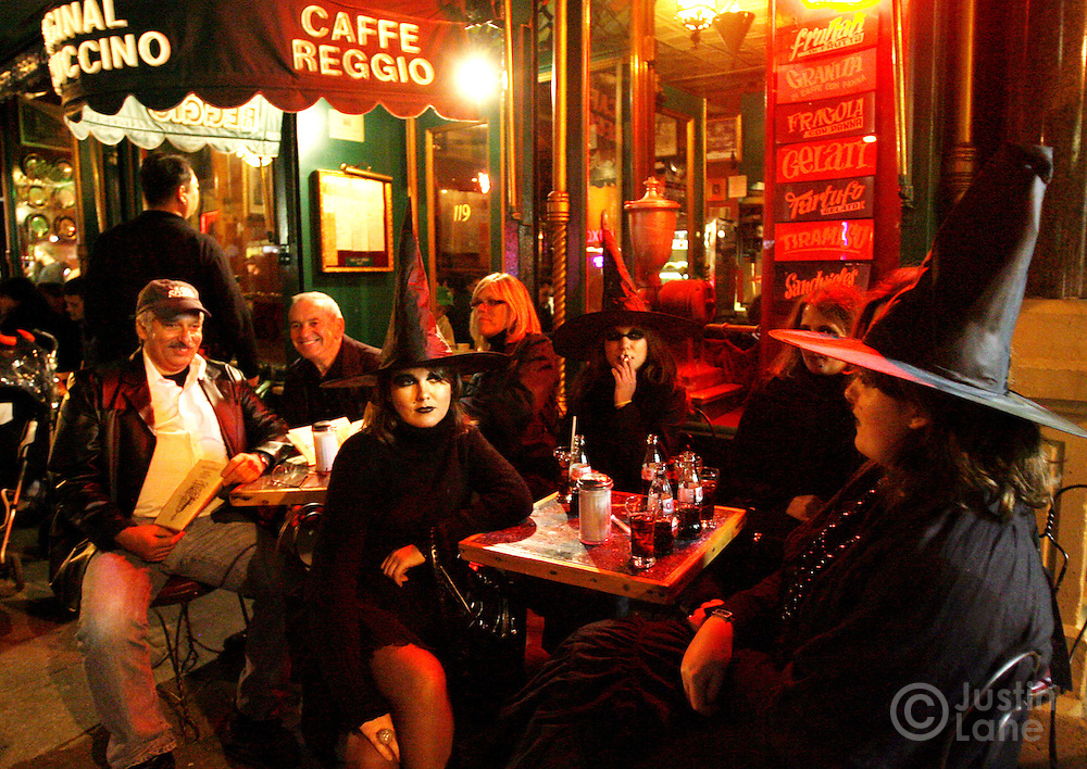 A group of women dressed as witches sit at an outdoor cafe in Greenwich Village during the anual HAlloween parade 31 October 2005.
