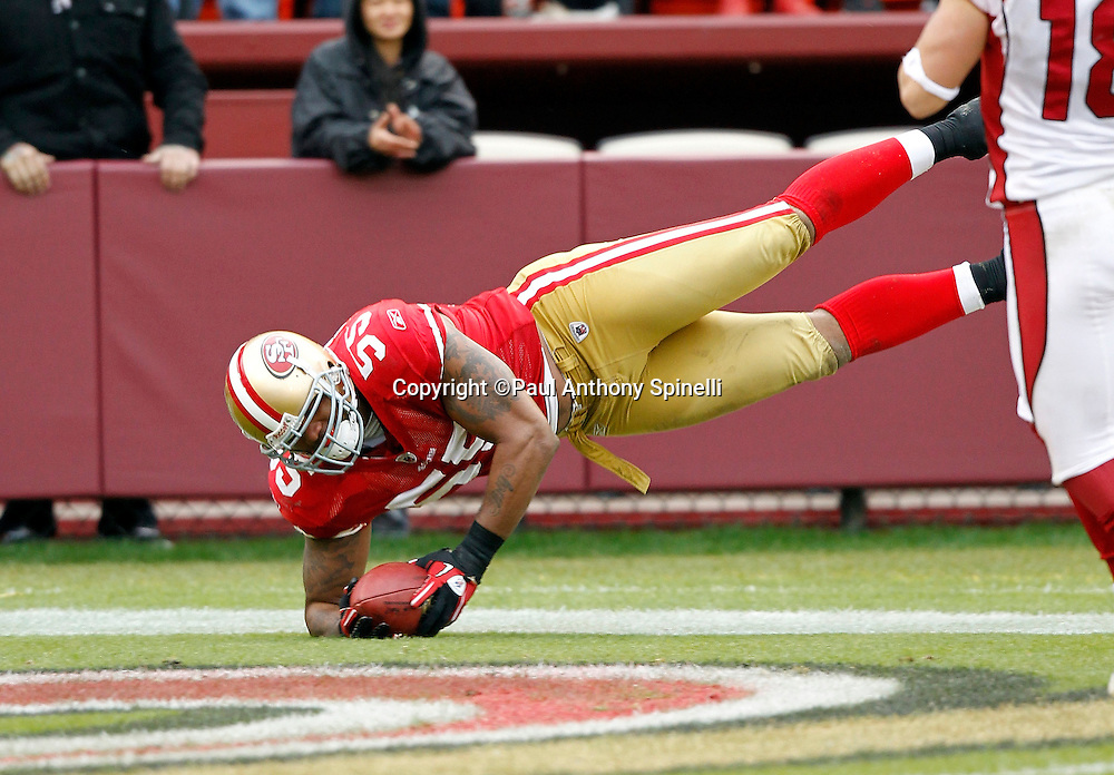 San Francisco 49ers linebacker Ahmad Brooks (55) intercepts and returns a third quarter pass during the NFL week 17 football game against the Arizona Cardinals on Sunday, January 2, 2011 in San Francisco, California. The 49ers won the game 38-7. (©Paul Anthony Spinelli)