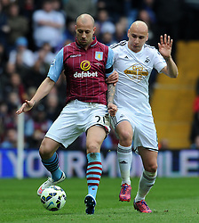Aston Villa's Alan Hutton is tackled by Swansea City's Jonjo Shelvey  - Photo mandatory by-line: Harry Trump/JMP - Mobile: 07966 386802 - 21/03/15 - SPORT - FOOTBALL - Barclays Premier League - Aston Villa v Swansea City - Villa Park, Birmingham, England.