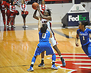 """Ole Miss' Courtney Marbra (25) vs. Kentucky's Jennifer O'Neill (0) in women's college basketball at the C.M. """"Tad"""" Smith Coliseum in Oxford, Miss. on Thursday, February 28, 2013. Kentucky won 90-65."""