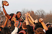 Webster Groves players and fans hoist Demetrius Robinson on their shoulders after his game winning touchdown with seconds left in the fourth quarter against Chaminade.