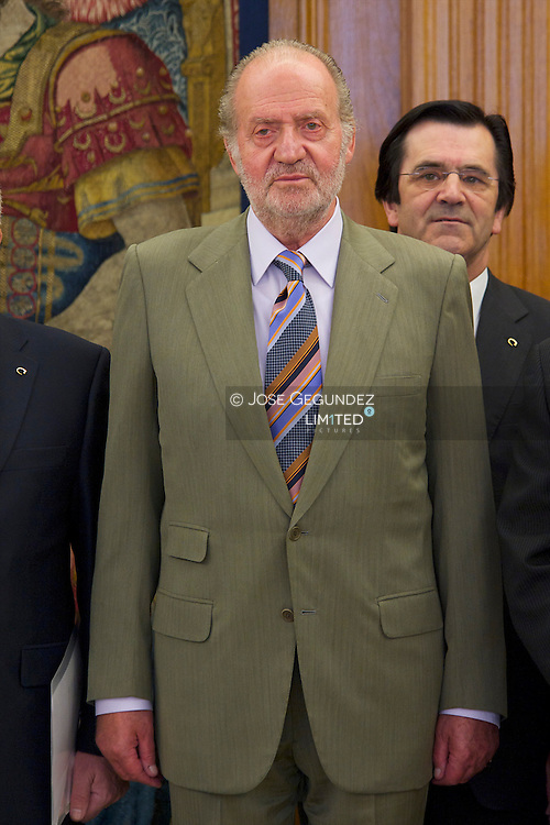 King Juan Carlos of Spain attends an audiences with Coviran members, chaired by D. Antonio Robles Lizancos to mark the 50 anniversary of the establishment of the cooperative at Zarzuela Palace in Madrid