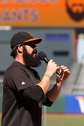 July 7, 2011; San Francisco, CA, USA;  San Francisco Giants relief pitcher Brian Wilson (38) hands out baseball gloves to members of the junior Giants little league teams before the game against the San Diego Padres at AT&T Park.